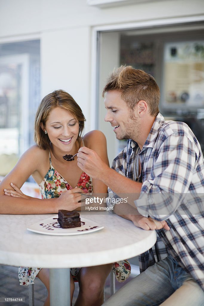 Couple sharing dessert at cafe : Stock Photo