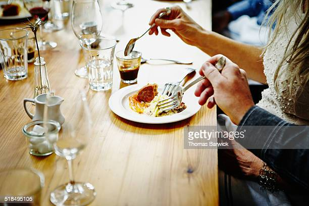 Couple sharing dessert at table in restaurant