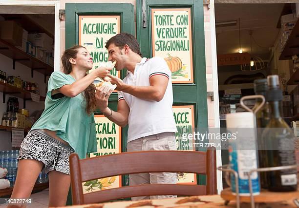Couple sharing food at cafe