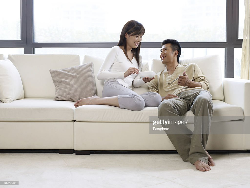 Couple sharing food. : Stock Photo