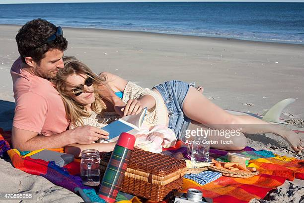 Couple sharing picnic on beach, Breezy Point, Queens, New York, USA
