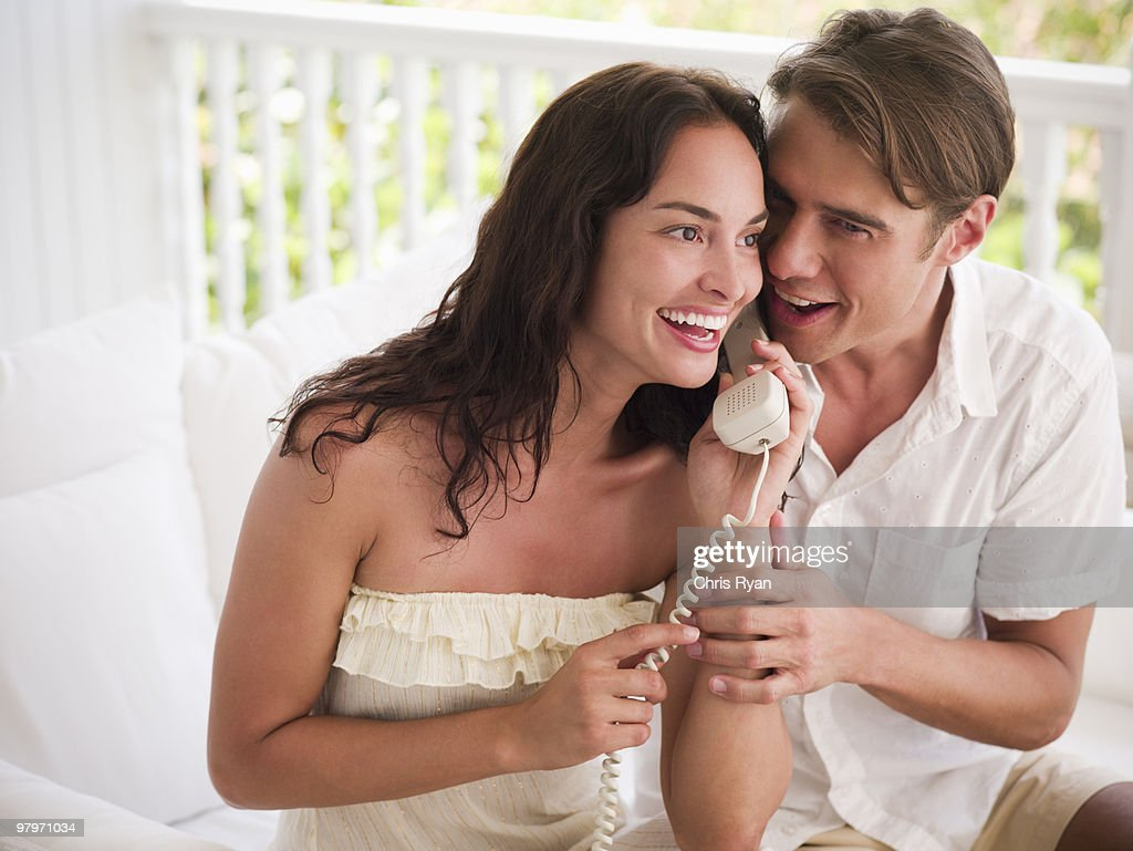 Couple sharing telephone : Stock Photo
