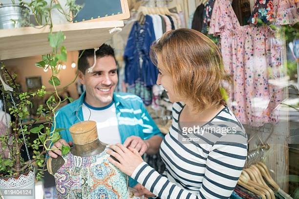 Couple shopping at a clothing store