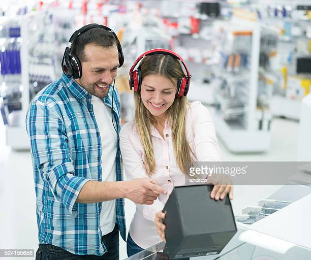 Couple shopping at an electronics store