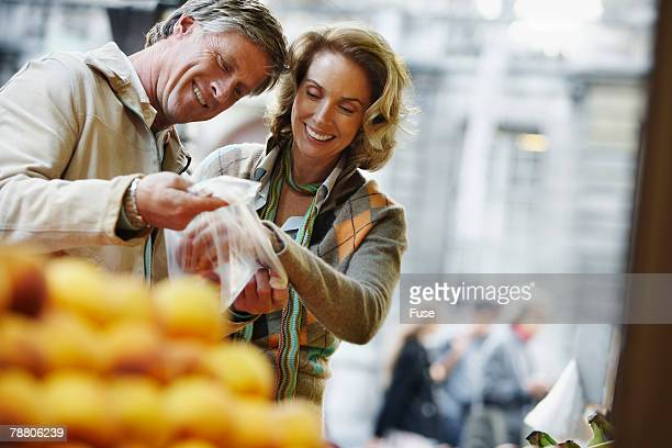 Couple Shopping at Fruit Stand