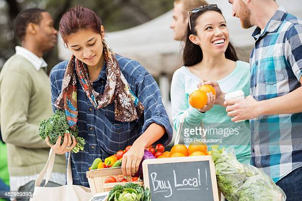 Couple shopping at local farmers market