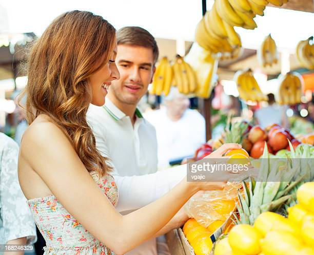 Couple shopping at market.