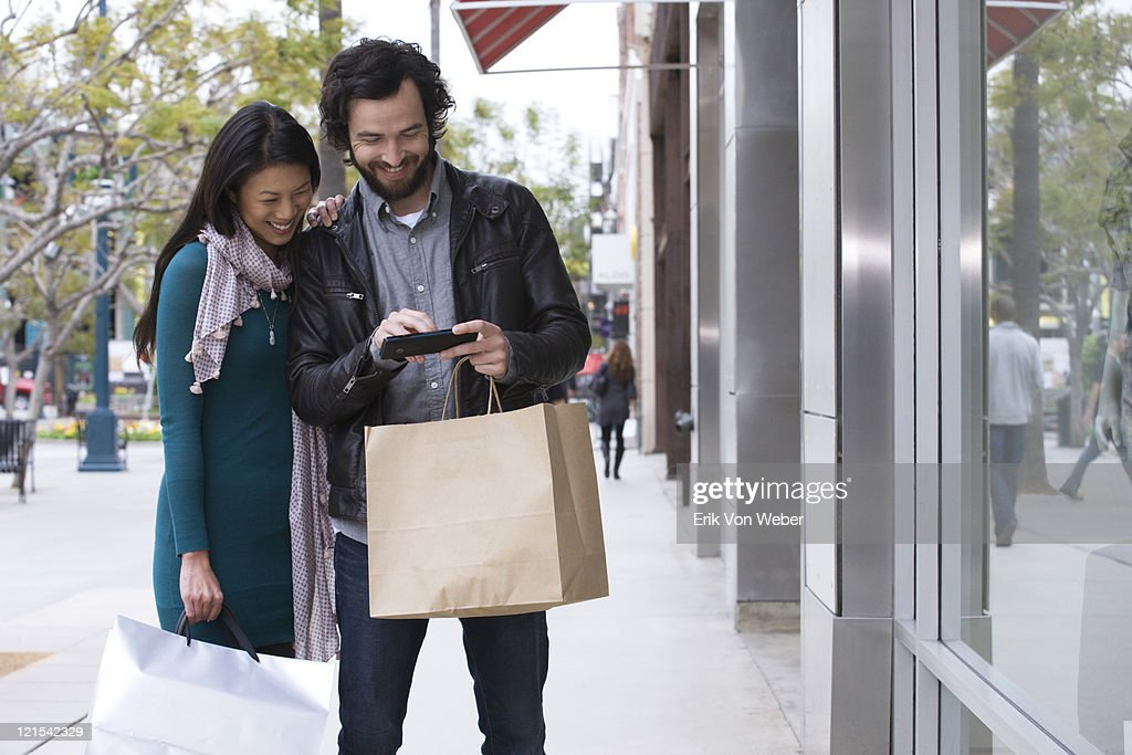 Couple shopping at outdoor market : Stock Photo