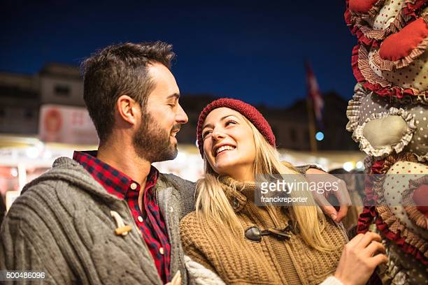 couple shopping at the christmas market