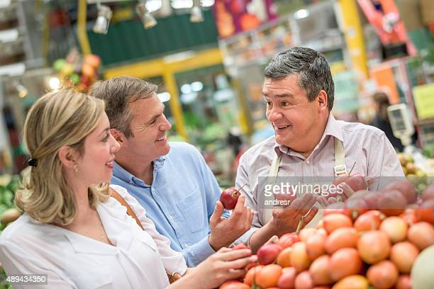 Couple shopping at the food market