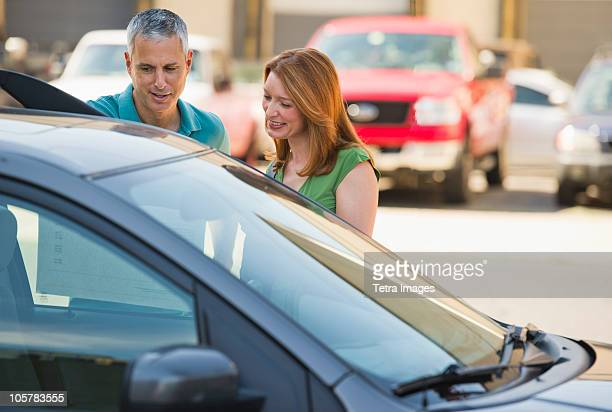 Couple shopping for a new car