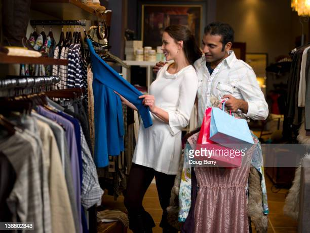 Couple shopping for clothing together