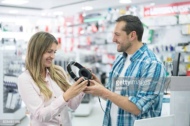 Couple shopping for headphones at a tech store