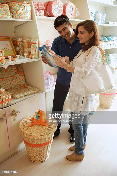Couple shopping in baby store