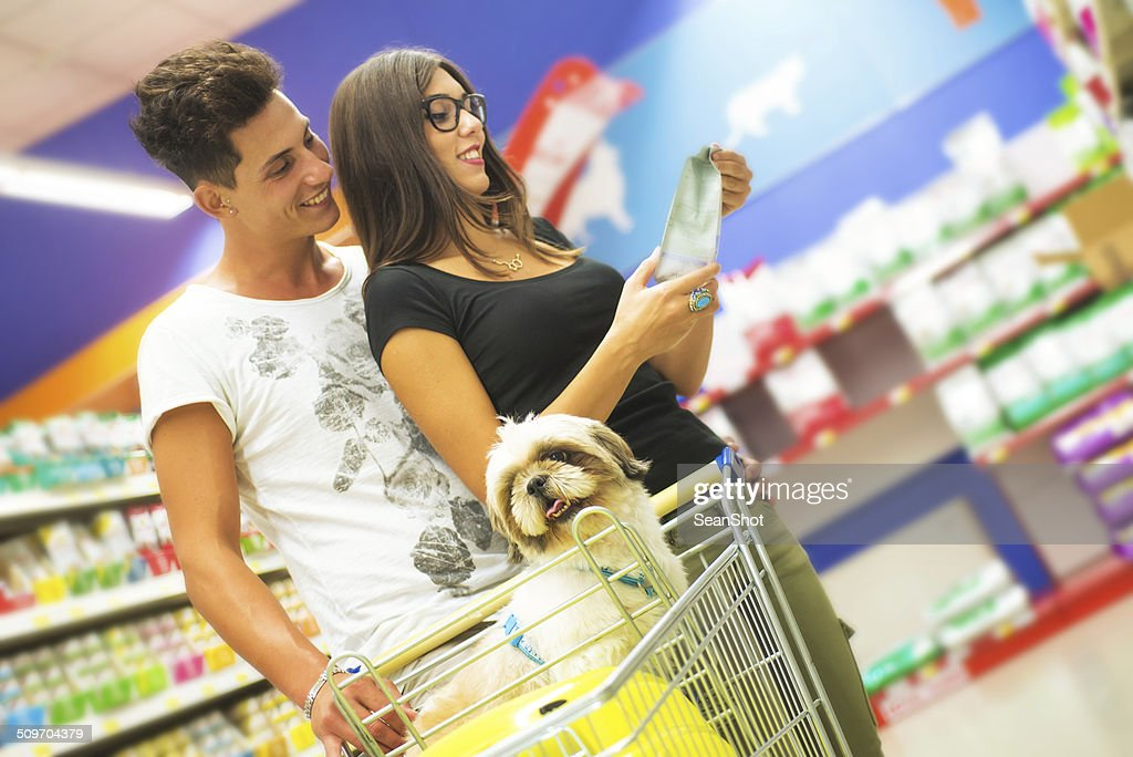 Couple Shopping in Pet Store with a Shih tzu