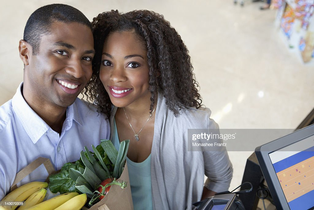 Couple shopping in supermarket : Stock Photo