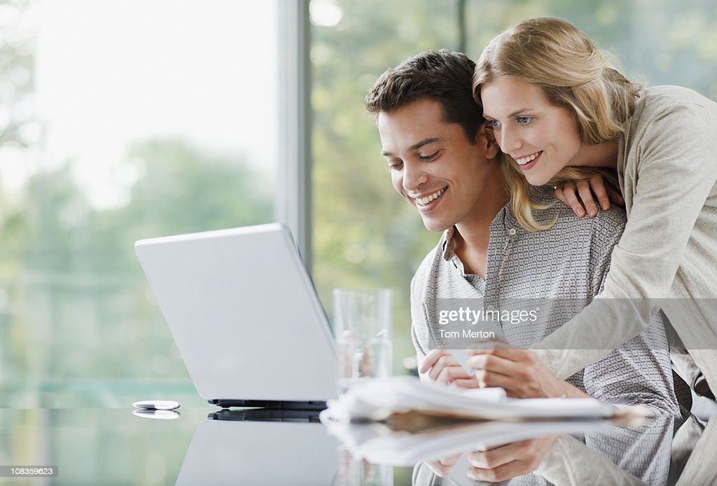 Couple shopping online with credit card : Stock Photo