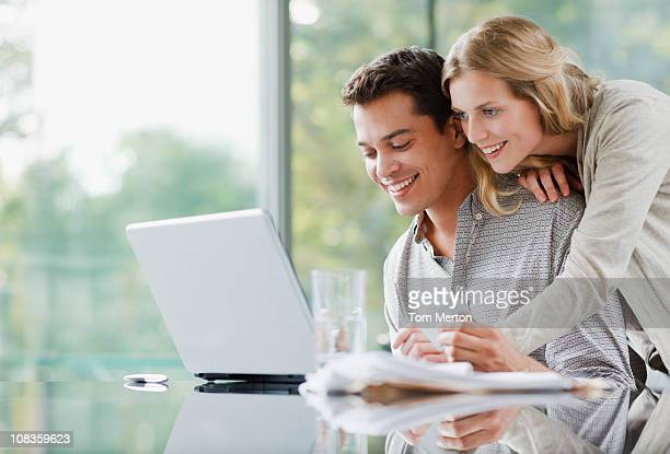 Couple shopping online with credit card