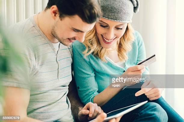 Couple Shopping Online WIth Tablet.
