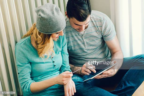 Couple Shopping Online With Their Credit Card Using Digital Tablet.