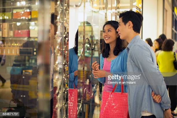 Couple shopping together in a shopping mall.