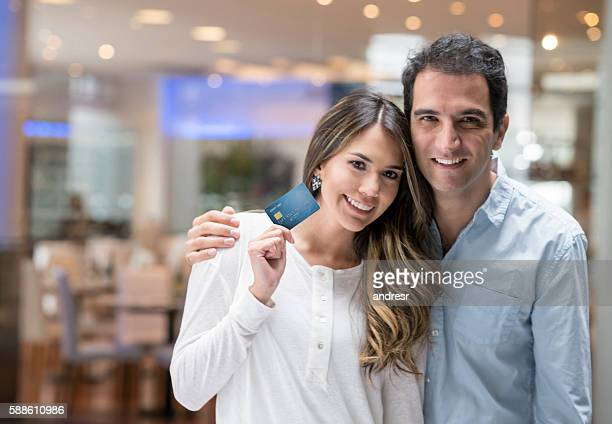 Couple shopping with a credit card