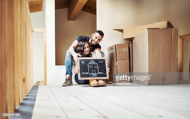 Couple Showing a House Drawn During a Moving