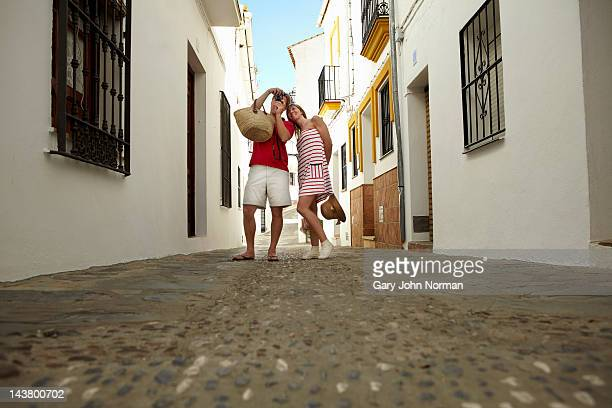 couple sight seeing in spanish town