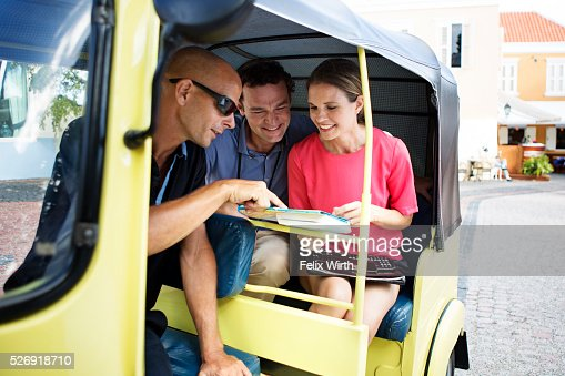 Couple sightseeing from tuk tuk with guide : Stock Photo