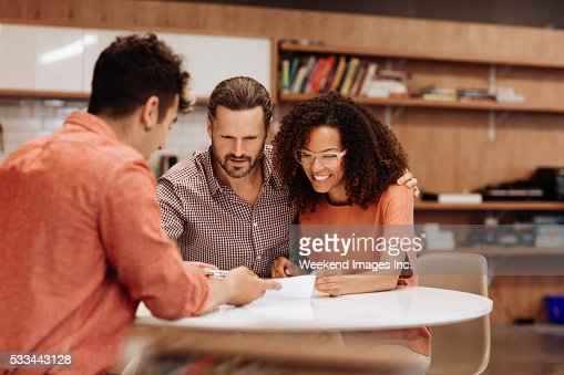 Couple signing a contract