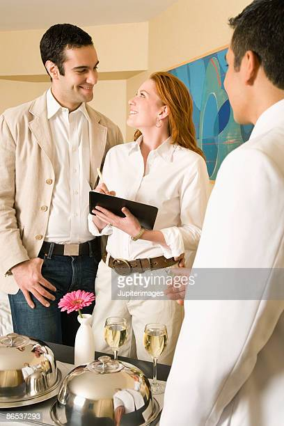 Couple signing bill for room service