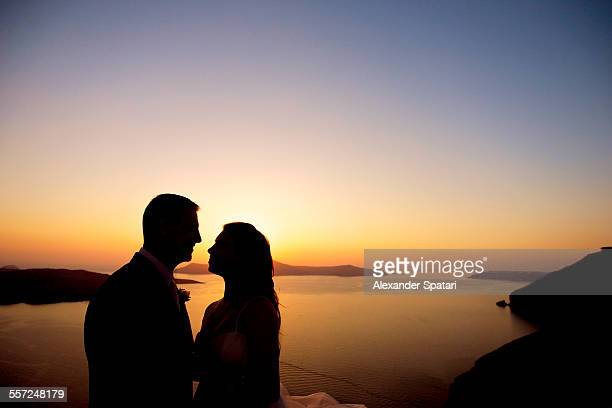 Couple silhouette at sunset in Santorini