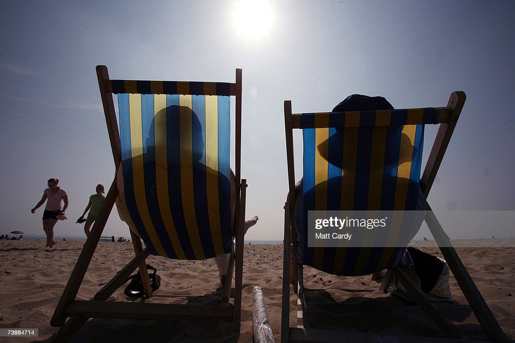A couple sit in deckchairs as they enjoy the hot weather on the sea front April 14, 2007 in Bournemouth, England. The un-seasonably warm weather has heralded the start to what weather forecasters predict will be a record breaking summer.