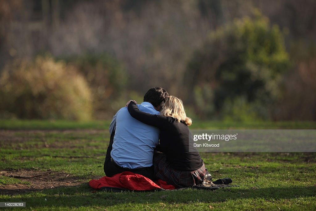 A couple sit in the sunshine in St James's Park on March 1, 2012 in London, England. After a recent cold snap Britain is expected to see a short period of unseasonably mild weather following one of the driest February's on record according to the Met Office.