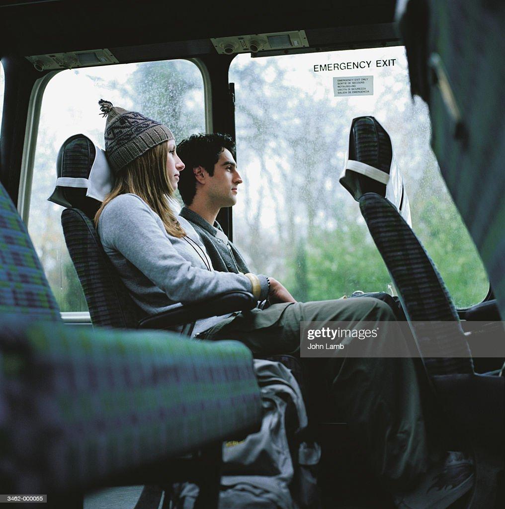 Couple Sit on Empty Bus : Stock Photo