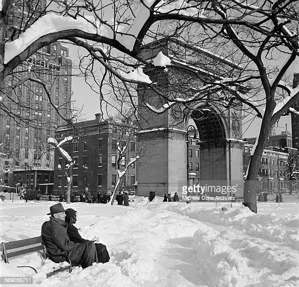 A couple sits near the Arch at Washington Square Park in New York New York