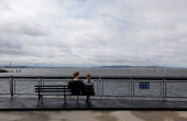 A couple sits on Valentino Pier in Red Hook Brooklyn as the skies clear in the aftermath of Hurricane Irene on August 28 2011 in New York City The...