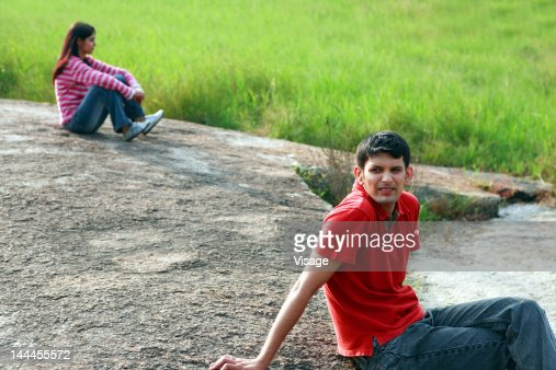 A couple sitting apart : Stock Photo