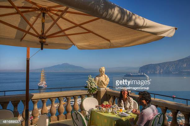 Couple sitting at a restaurant on the terrace of a hotel Sorrento Campania Italy