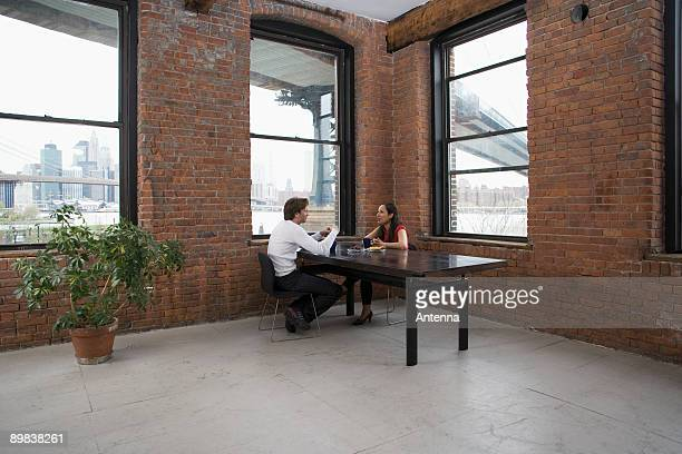 A couple sitting at a table together