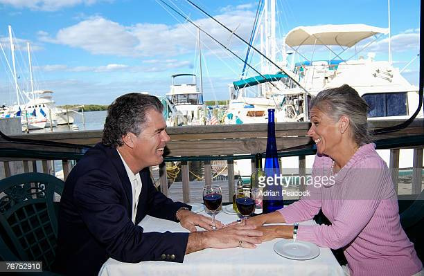 Couple sitting at seaside restaurant