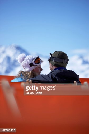 Couple sitting close in chair lift : Stock Photo