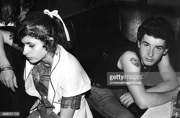 Couple sitting in a booth The George pub Hammersmith London 1976