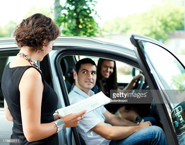 Couple sitting in a car ready to buy