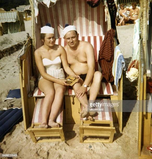 Couple sitting in a wicker beach chair on a beach near Cuxhaven North Sea