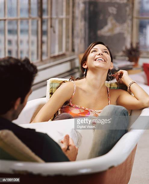 Couple Sitting in an Empty Bath, Man Sketching a Woman