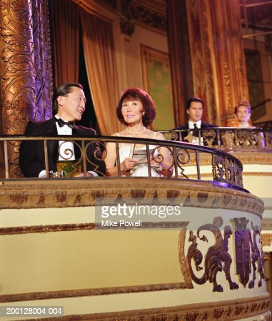 Couple sitting in balcony of theater