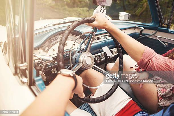 Couple sitting in convertible
