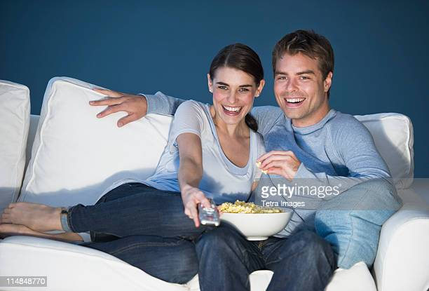 Couple sitting in front of television