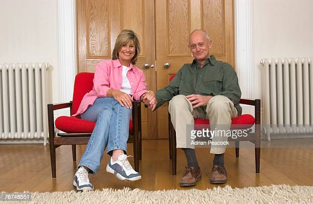 Couple sitting in matching chairs